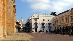 San Pedro Claver church (left), the Cathedral (center, at the end of street) and the Plaza San Pedro Claver, in Cartagena.Colombia.