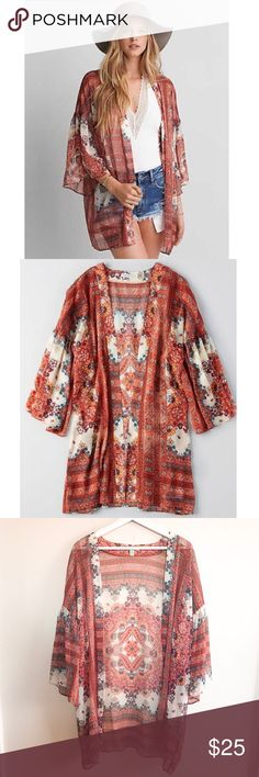 "American Eagle Floral Sheer Bell Sleeve Kimono American Eagle Orange Floral Sheer Bell Sleeve Kimono Size XS/S Burnt orange/terracotta/white/cream/blue colors 3/4 bell sleeves Oversized and flowy Semi-sheer 32"" length Boho/festival wear. Looks perfect with a body suit and jean shorts! Excellent pre-owned condition American Eagle Outfitters Sweaters Cardigans"