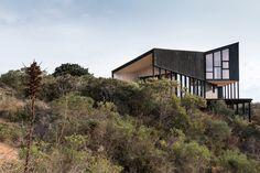 Casa Encallada is a minimalist residence located in Algarrobo, Chile, designed by WHALE!