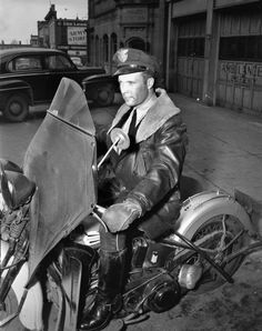 Police Officer Robert O'Brien on Motorcycle   Photograph   Wisconsin Historical Society