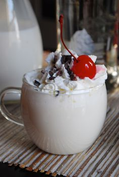 Whipped Vodka Vanilla White Hot Chocolate with Cocoa Nibs by Alejandra of Always Order Dessert. Follow the link for more fabulous hot chocolate recipe ideas!