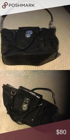 Michael Kors cross body handbag Silver accented MK black cross body chained handbag with signature lining inside.Crocodile leather bottom. NWOT KORS Michael Kors Bags Crossbody Bags