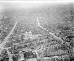 Oblique aerial view of part of the devastated Walle district of Bremen, looking south-east towards the Altstadt. Note the large, undamaged, public air-raid shelter (Luftschutzbunker), standing on Zwinglistrasse in the foreground. Between the nights of 17/18 May 1940 and 22/23 April 1945, Bomber Command dropped over 12,800 tons of bombs on the city. CL 3259 Part of AIR MINISTRY SECOND WORLD WAR OFFICIAL  Royal Air Force official photographer