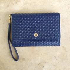 Tory Burch Marion Embossed Smartphone Wristlet NWT Authentic. Brand new with tag and gift pack. Color Tory Navy. 4 slots for credit cards. 7 pockets for bills. Fit for iPhones 4/5/6. (One pocket bill can fit for iPhone 6+ without case). Exterior zipper pouch for coins. No trade. Tory Burch Bags Wallets