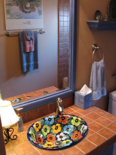 Cute sink with solid tile countertop.  Don't know if I like terra-cotta tile on countertop.