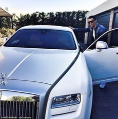 Cristiano Ronaldo made his commute to work look easy as he left in a white Rolls-Royce Ghost