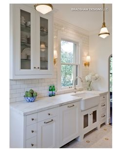 Small kitchen with one upper cabinet. Full subway tile to ceiling.