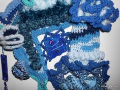 Close up of some of the crochet and another piece of fused glass