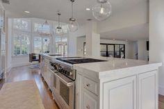 Kitchen - The island boasts a stainless steel oven and gas range. - Austin house rental