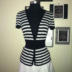 White House Black Market Cap Sleeve V Neck Top Black stripe White stripe Chic all over!!! Make a statement in the chic top with graphic stripes classic cap sleeve deep v neckline with 3 button closure. Perfect over a sleeveless dress or a tank top for Weekday Chic! White House Black Market Tops