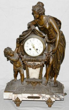 figural antique clocks | You May Also Like :