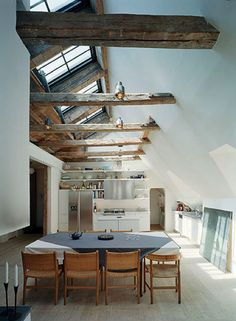 Great beams and windows in this open dining space. LOVE!