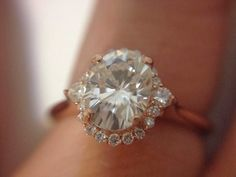 Rose Gold Engagement ring, oval, halo.