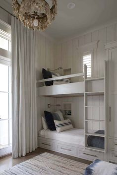 Great way to put guest sleeping space in a home office or tv room when there's no proper guest room. Use a similar swag of floor to ceiling curtain to hide space during work time hours. Bunk Rooms, Bunk Beds, Home Bedroom, Bedroom Decor, Beach House Bedroom, Kids Bedroom, Cottage Bedrooms, Bedroom Lamps, Wall Lamps