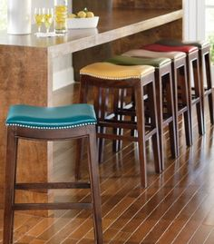 Spend more time at the bar in the clean style and irresistible comfort of leather bar stools (with tip money left over).