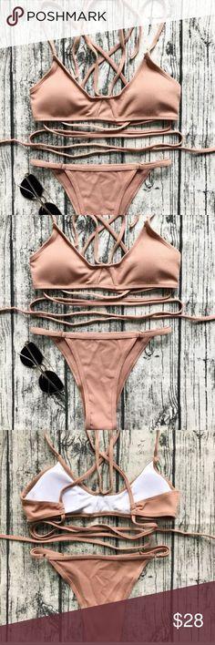 Tan nude bikini m top S bottoms Brand is unknown super cute never worn Nasty Gal Swim Bikinis