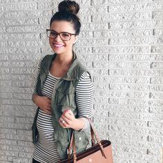 She is super cute! Bun, vest, bag, stripes