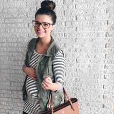 She is super cute! Bun, vest, bag, stripes