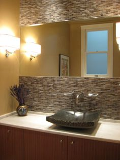 20 Eye-Catching Bathroom Backsplash Ideas | Stone backsplash ...