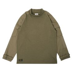 Expertly designed new Tactical Mockneck Longsleeve Shirt from Wtaps. Mixing military inspired detailing into this classic cotton jersey shirt, the Tactical Longsleeve features a mock turtle neck, ripstop raglan sleeves, premium cotton jersey constructed body, utility pockets at both arms, adjustable velcro cuffs, plus Wtaps' signature branding throughout.