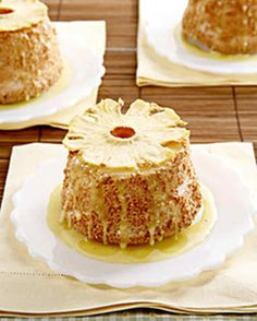 This light and airy cake is drizzled with a sweet lemon-pineapple curd and topped with a slice of dried pineapple.