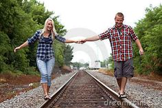 Sonya i love this on train tracks Couple photography