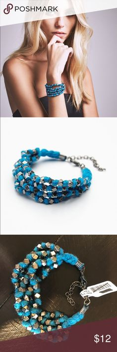 Free People nueve blue Beaded layer bracelet Brand new with tag! Add a pop of color to your arm candy with this multi-strand cotton bracelet with metal charm accents. Adjustable lobster clasp closure.  Cotton Metal Import Free People Jewelry Bracelets