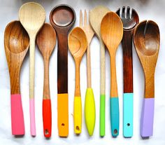 These wooden spoons have dipped handles in rainbow colours.