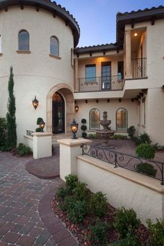 This home's Spanish Mediterranean styling incorporates signature design elements, including a dramatic arched entryway and stucco.