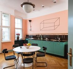 Love so much about this kitchen - the table, chairs, light, colour, rail and the wall art