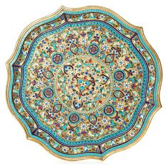 A GILT SILVER AND CLOISONNE ENAMEL TRAY, KIEV, CIRCA 1894 the stippled gilt silver ground with scrolling polychrome cloisonne enamel designs diverging from a central floral rosette; the body decorated with vegetal ornaments in opaque, translucent, and shaded enamels; diameter: 29 cm (11 3/8 in.), dated assayer's mark, Kiev town mark, 84 standard