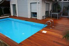 Terrasse und Pool-Umrandung aus Bilinga-Terrassendielen von Holzhandel-Deutschland