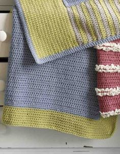 Free Crochet Pattern 70190A Make It Yours Bordered Blankie : Lion Brand Yarn Company. I love this pattern. I add a third color between body and border and also as a final border row.