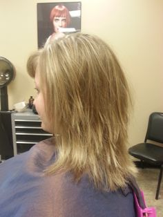Medium, textured haircut.  Blonde highlights into natural sandy-blonde hair. Aveda color.