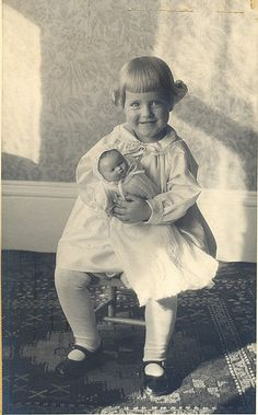 Vintage photo of little girl with doll. I love how utterly delighted she looks.