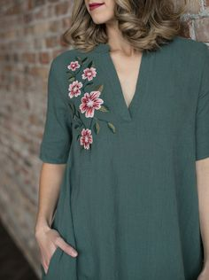 Light, linen fabric dress with embroidered flowers. Pair it with your fav chunky cardigan or leggings for the perfect fall layered look. It's a looser fit and it has pockets! The perfect V neck detail with elbow length sleeves and a straight knee length hem. You will LIVE in this dress!