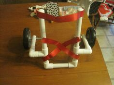 DIY photo tutorial to make a small dog wheelchair w/ wheels and PVC pipes you can get at Home Depot or Lowes.
