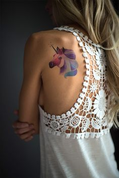 Unicorn watercolor tattoo. I want one.