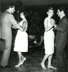 Audrey Hepburn dancing with Eddie Fisher and Mel Ferrer dancing with Elizabeth Taylor