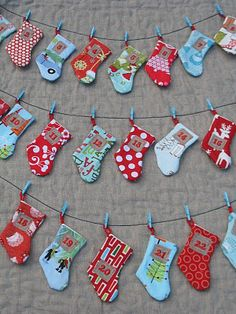 Another version of the stocking advent calendar... Doesn't even need background fabric! Just some ribbon, mini clothespins, and somewhere to hang!