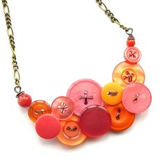 Tangerine Orange and Coral Pink Vintage button necklace by buttonsoupjewelry. $32.00, via Etsy.