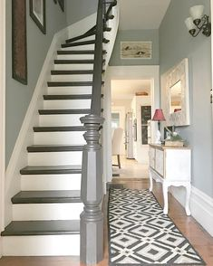 Entryway by @designsbykaran Walls are Benjamin Moore Piedmont Gray; trim is cloud white by Benjamin Moore; railing is General Finishes espresso gel stain.