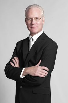 If Tim Gunn lived next door...  He would be the  kindest of neighbors; but I could never wear my sweatpants outside the house again.  Carry on!
