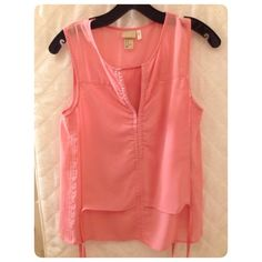 H & M sleeveless blouse H & M blouse in coral with side ties , super cute but it's a little small for me now , has a small dot on the front , size 2 H&M Tops Blouses