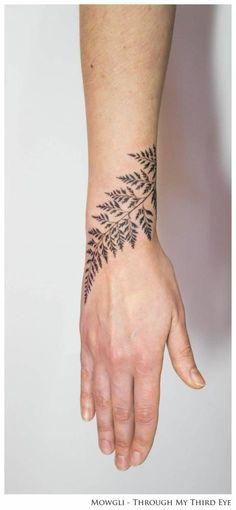 Fern leaf tattoo on the right wrist, titled 'Horticulture Fluidity'. Tattoo artist: Mowgli