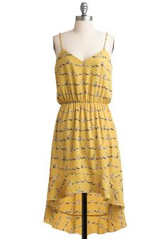 adorable summer dress with the high front and longer back....would look great with a cardi tall brown boots and a cute belt too