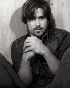 COLIN FARRELL How surprising... I'm not usually attracted to photos of a pretty face framed by a pair of knees.