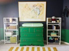 A gorgeous bold boy's nursery in rich jewel tones of sapphire, emerald and gold with a fabulous painting to off set it all