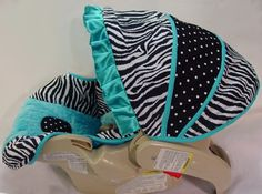 Custom Boutique Turquoise Aqua and Zebra Infant Car Seat Cover. $109.00, via Etsy.