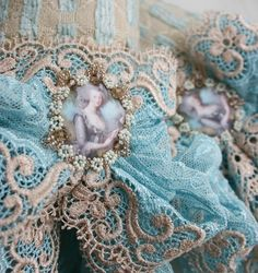 Mary Moorkens, from Dublin, Ireland.   She's fabulous, dreamy, creative -- and she designs textile jewelry and cuffs under the name Queen of Cuffs on etsy.